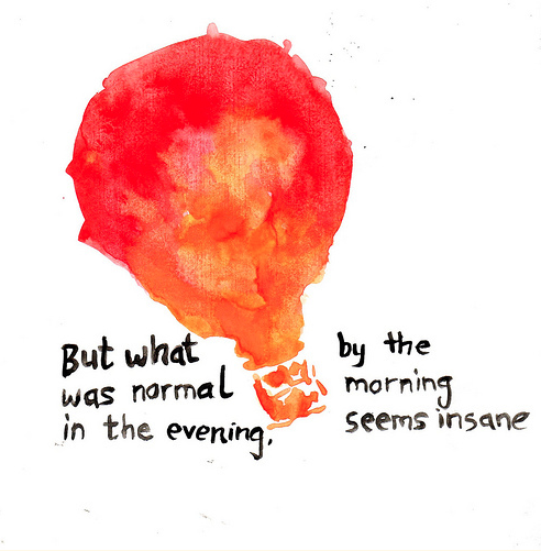 roughly painted lightbulb with the phrase 'But what was normal in the evening, by morning seems insane'