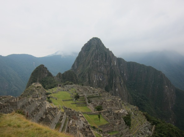 The ruins of Machu Picchu seen from above with the mountain of Huayna Picchu in the background