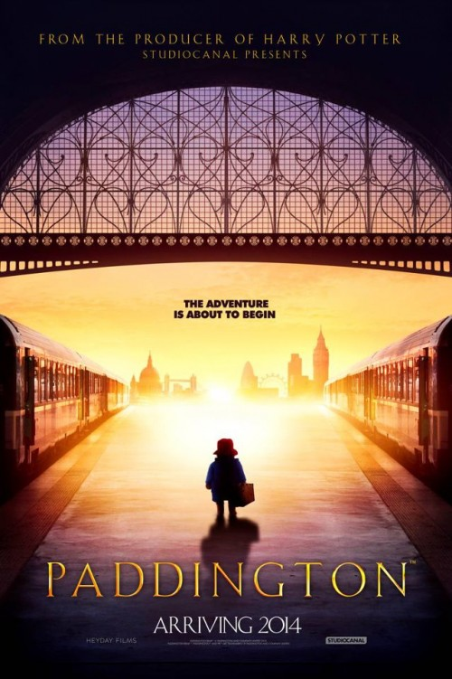 poster for upcoming Paddington Bear movie, featuring a silhouette of the bear in question standing on a train platform. Caption reads: The Adventure is about to begin. Arriving 2014