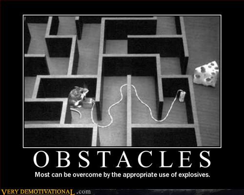 Mouse in a maze with no clear way to the cheese. The mouse has set explosives on the wall closest to the cheese and laid wire back into the maze to where it can safely set the explosives off. Caption reads: Obstacles. Most can be overcome by the appropriate use of explosives.