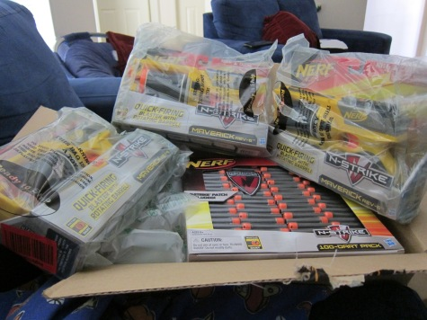 Array of just unboxed Nerf Mavrick guns and ammo