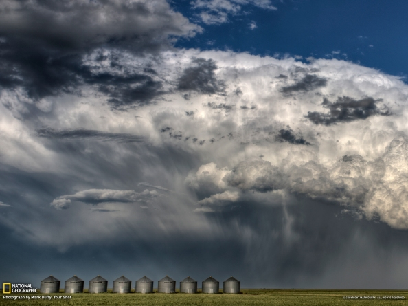 A major thunderhead masses near Briercrest, Saskatchewan, in August 2011. Dramatic and beautiful clouds form above a field.