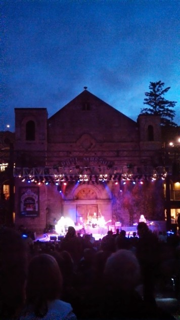 CCR rock out on stage at dusk