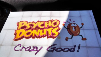 Psycho Donuts box, featuring a terrified appearing donut running away and the caption: Crazy Good!
