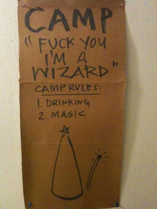 Piece of cardboard on which is written -- Camp 'Fuck You I'm a Wizard' Camp Rules: 1. Drinking, 2. Magic (and then there's a sketch of a pointy wizard hat and wand)