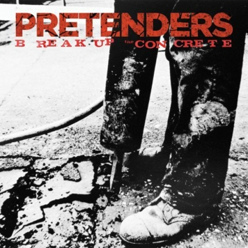 Album cover of The Pretenders' 'Break Up the Concrete'. A photo of someone from the knees down with dirty trousers and shoes directing a road drill into the ground and, well, breaking the concrete.